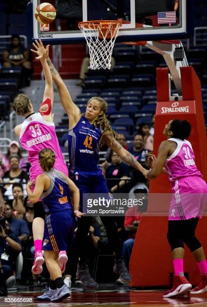 Washington Mystics center Emma Meesseman gets a shot off over Phoenix Mercury center Brittney Griner during a WNBA game on August 18 between the...
