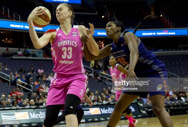 Washington Mystics center Emma Meesseman hauls in the ball in front of Phoenix Mercury forward Camille Little during a WNBA game on August 18 between...