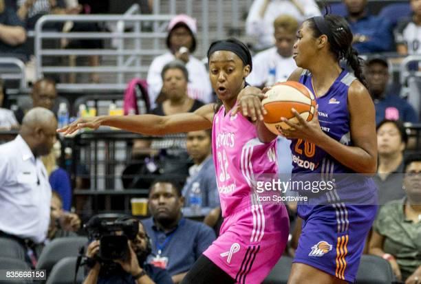 Washington Mystics center Emma Meesseman intruders with Phoenix Mercury forward Camille Little during a WNBA game on August 18 between the Washington...