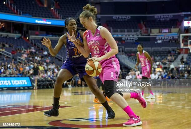 Washington Mystics center Emma Meesseman moves past Phoenix Mercury forward Camille Little during a WNBA game on August 18 between the Washington...