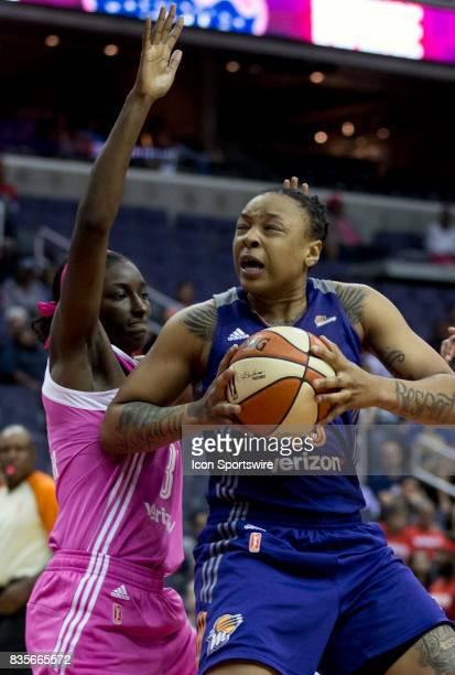 Washington Mystics forward Asia Taylor defends against Phoenix Mercury forward Emma Cannon during a WNBA game on August 18 between the Washington...