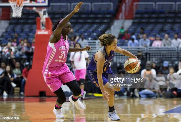 Washington Mystics forward Asia Taylor defends against Phoenix Mercury guard Leilani Mitchell during a WNBA game on August 18 between the Washington...