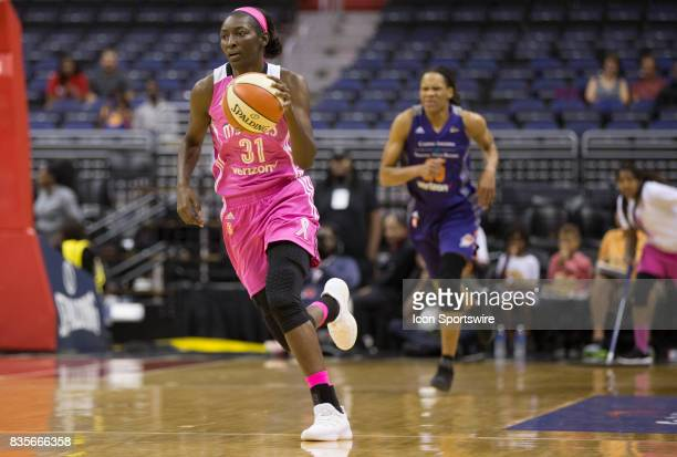 Washington Mystics forward Asia Taylor drives up court during a WNBA game on August 18 between the Washington Mystics and the Phoenix Mercury at...