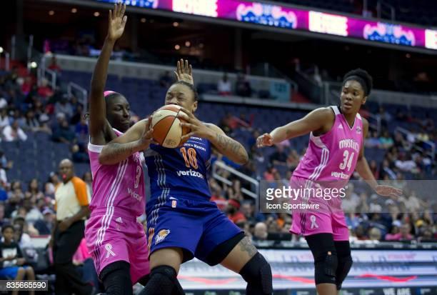 Washington Mystics forward Asia Taylor press up to Phoenix Mercury forward Emma Cannon during a WNBA game on August 18 between the Washington Mystics...