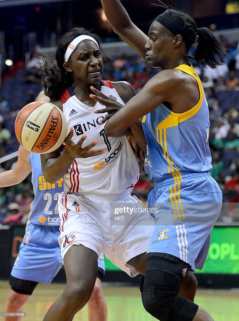 Washington Mystics forward Crystal Langhorne (1) has the ball slip from her grip while defended by Chicago Sky center Sylvia Fowles (34) in the third quarter at the Verizon Center in Washington, D.C., Wednesday, July 24, 2013, The Mystics defeated the Sky, 82-78.
