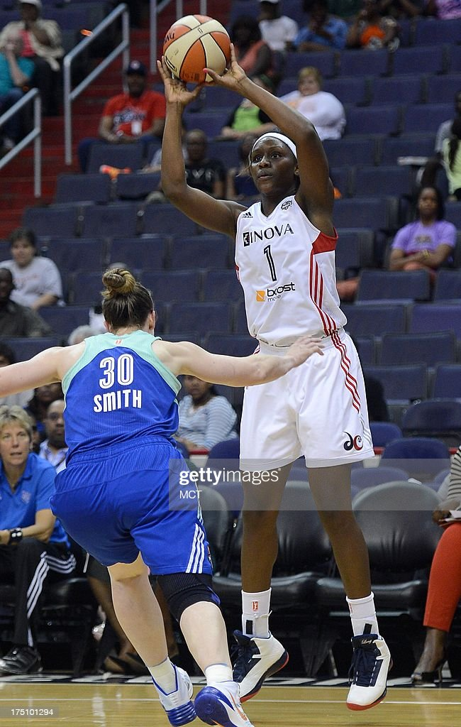 Washington Mystics forward Crystal Langhorne (1) hits a three-point shot over New York Liberty guard Katie Smith (30) in the fourth quarter at the Verizon Center in Washington, D.C., Wednesday, July 31, 2013, The Liberty defeated the Mystics, 88-78.