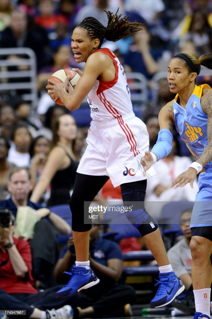 Washington Mystics forward Monique Currie (25) pulls down a rebound against the Chicago Sky in the third quarter at the Verizon Center in Washington, D.C., Wednesday, July 24, 2013, The Mystics defeated the Sky, 82-78.