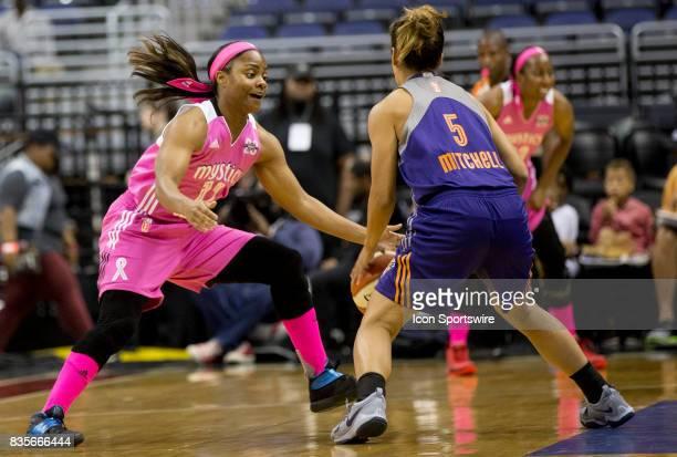 Washington Mystics guard Ivory Latta defends against Phoenix Mercury guard Leilani Mitchell during a WNBA game on August 18 between the Washington...
