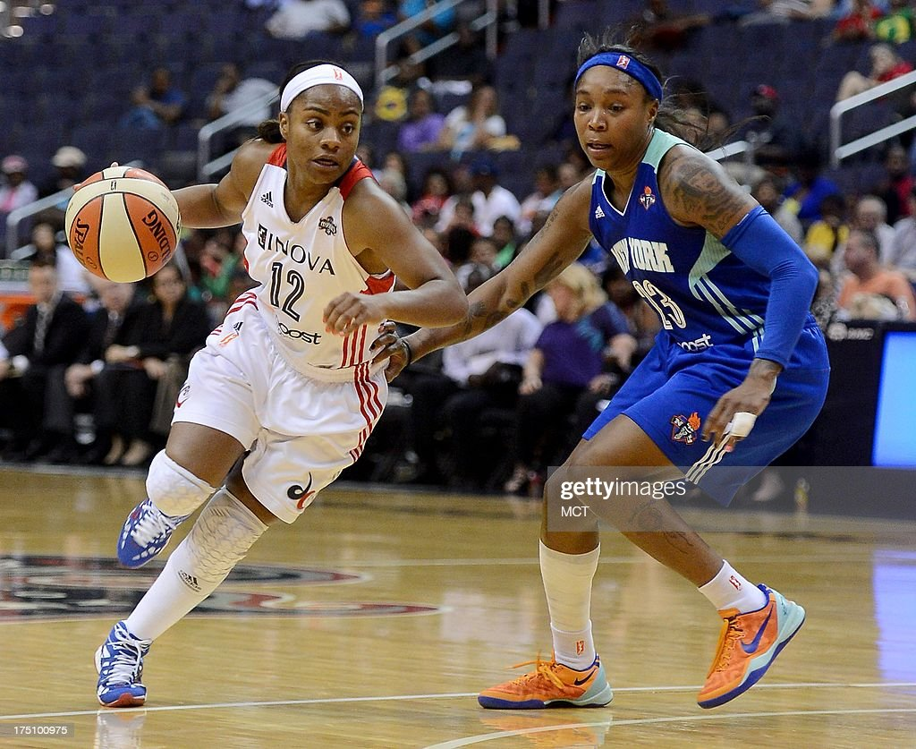 Washington Mystics guard Ivory Latta (12) dribbles against New York Liberty guard Cappie Pondexter (23) in the third quarter at the Verizon Center in Washington, D.C., Wednesday, July 31, 2013, The Liberty defeated the Mystics, 88-78.