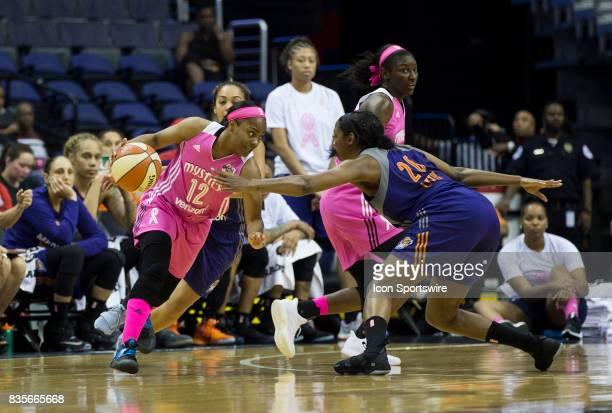 Washington Mystics guard Ivory Latta drives past Phoenix Mercury forward Camille Little during a WNBA game on August 18 between the Washington...