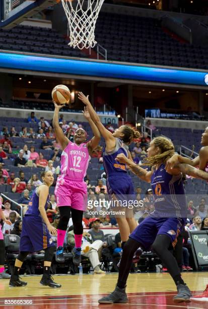Washington Mystics guard Ivory Latta shoots past Phoenix Mercury guard Leilani Mitchell during a WNBA game on August 18 between the Washington...