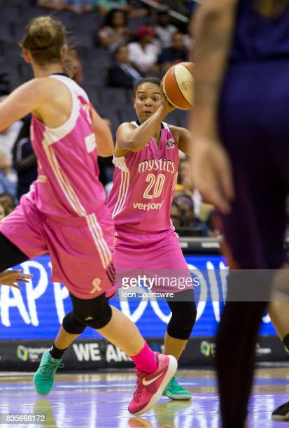 Washington Mystics guard Kristi Toliver about to make a pass during a WNBA game on August 18 between the Washington Mystics and the Phoenix Mercury...