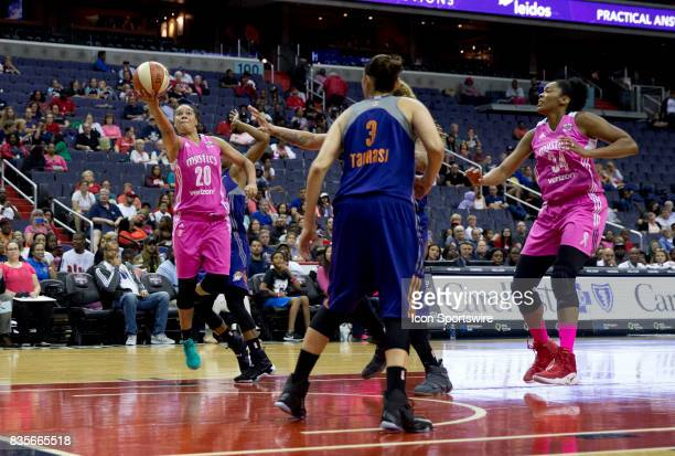 Washington Mystics guard Kristi Toliver lobs in a shot under the basket during a WNBA game on August 18 between the Washington Mystics and the...