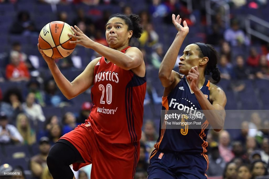 Washington Mystics guard Kristi Toliver (20) shoots for two of her nine points around Connecticut Sun guard Jasmine Thomas (5) in the fourth period at Capital One Arena August 29, 2017 in Washington, DC. The Washington Mystics lost to the Connecticut Sun 86-76.