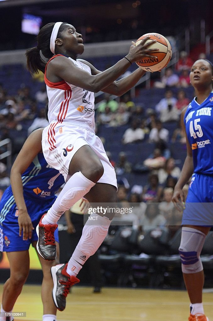 Washington Mystics guard Matee Ajavon (22) scores against the New York Liberty in the third quarter at the Verizon Center in Washington, D.C., Wednesday, July 31, 2013, The Liberty defeated the Mystics, 88-78.
