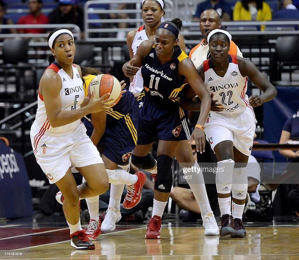 Washington Mystics guard Nadirah McKenith (5) comes away with the ball after a scramble for a rebound between Mystics and Indiana Fever players in the third quarter at the Verizon Center in Washington, D.C., Sunday, July 21, 2013, The Fever defeated the Mystics, 65-52.