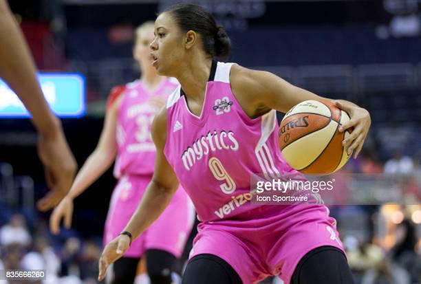 Washington Mystics guard Natasha Cloud controls the ball during a WNBA game on August 18 between the Washington Mystics and the Phoenix Mercury at...