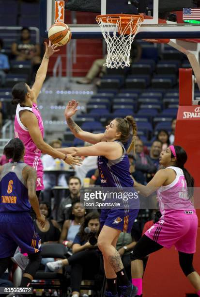 Washington Mystics guard Natasha Cloud shoots past Phoenix Mercury center Cayla George during a WNBA game on August 18 between the Washington Mystics...