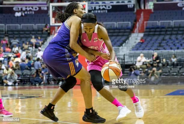 Washington Mystics guard Shatori WalkerKimbrough pushes past Phoenix Mercury forward Monique Currie during a WNBA game on August 18 between the...