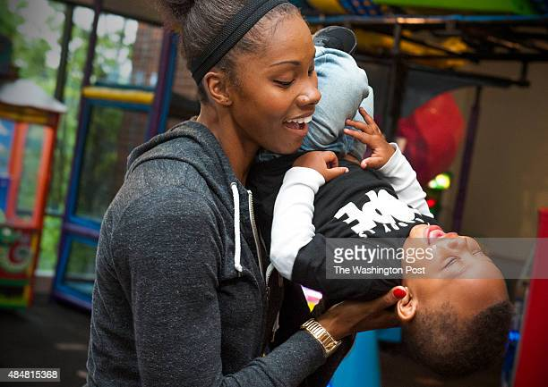Washington Mystics guard Tayler Hill shares a light moment with her son Maurice Lighty at Chuck E Cheese's August 18 2015 in Edina MN They were...