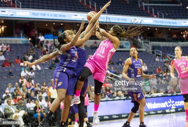 Washington Mystics guard Tierra RuffinPratt shoots past Phoenix Mercury center Brittney Griner and forward Camille Little during a WNBA game on...