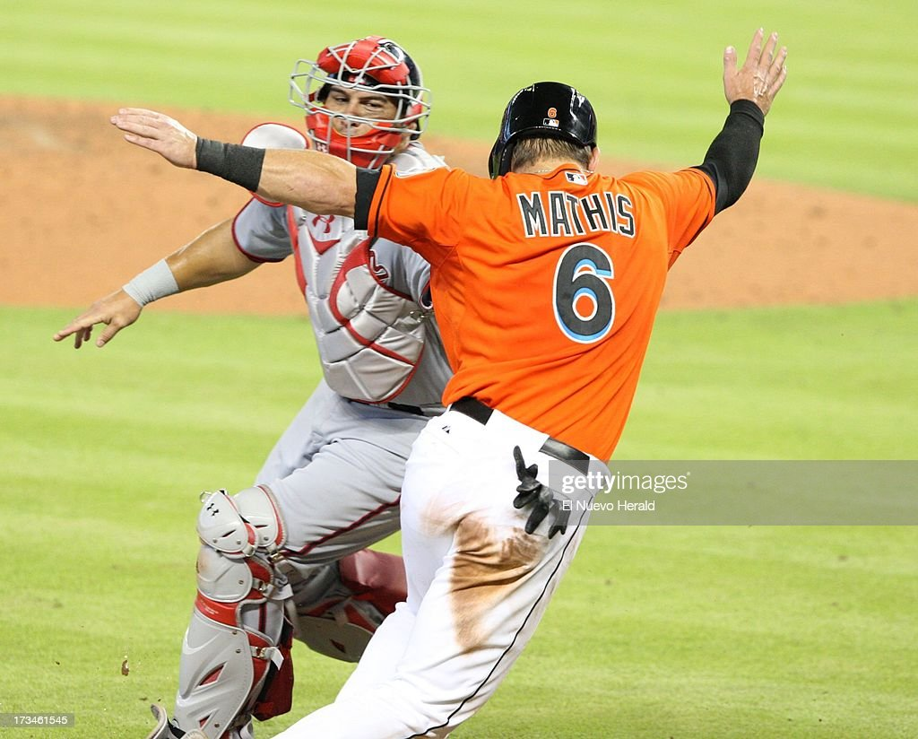 Washington Nationals catcher Wilson Ramos tags out Miami Marlins' Jeff Mathis during the third inning at Marlins Park in Miami, Florida, Sunday, July 14, 2013.
