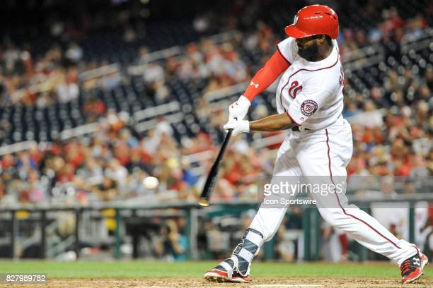 Washington Nationals center fielder Brian Goodwin hits a ninth inning single during an MLB game between the Miami Marlins and the Washington...