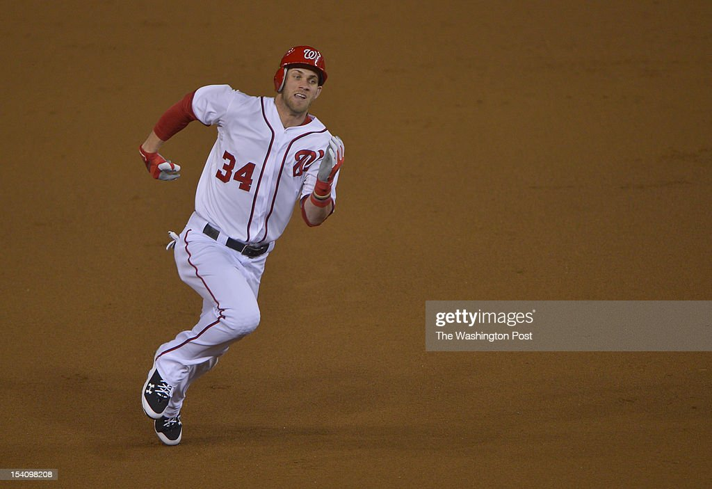 Washington Nationals center fielder Bryce Harper (34) heads to third base after a 1 run triple in the first inning of the NLDS Game 5 against St. Louis Cardinals at Nationals Park on October 12, 2012 in Washington, D.C.