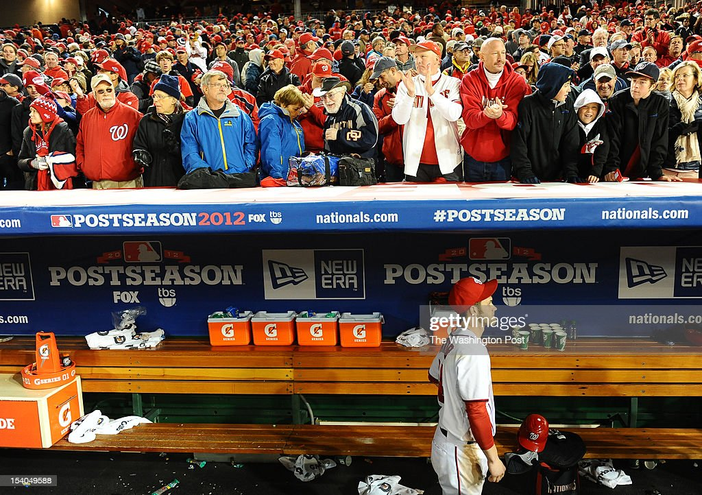 Washington Nationals center fielder Bryce Harper (34) slowly leaves the dugout following their 9-7 loss to the St. Louis Cardinals during game five of the NLDS on Oct. 12, 2012 in Washington, DC