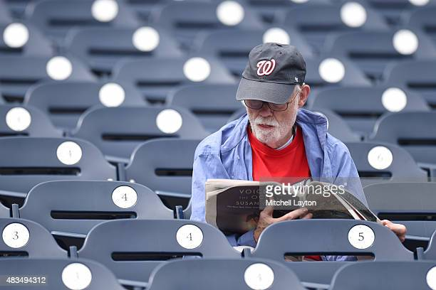 Washington Nationals fan reads the newspaper before a baseball game against the Colorado Rockies at Nationals Park on August 9 2015 in Washington DC