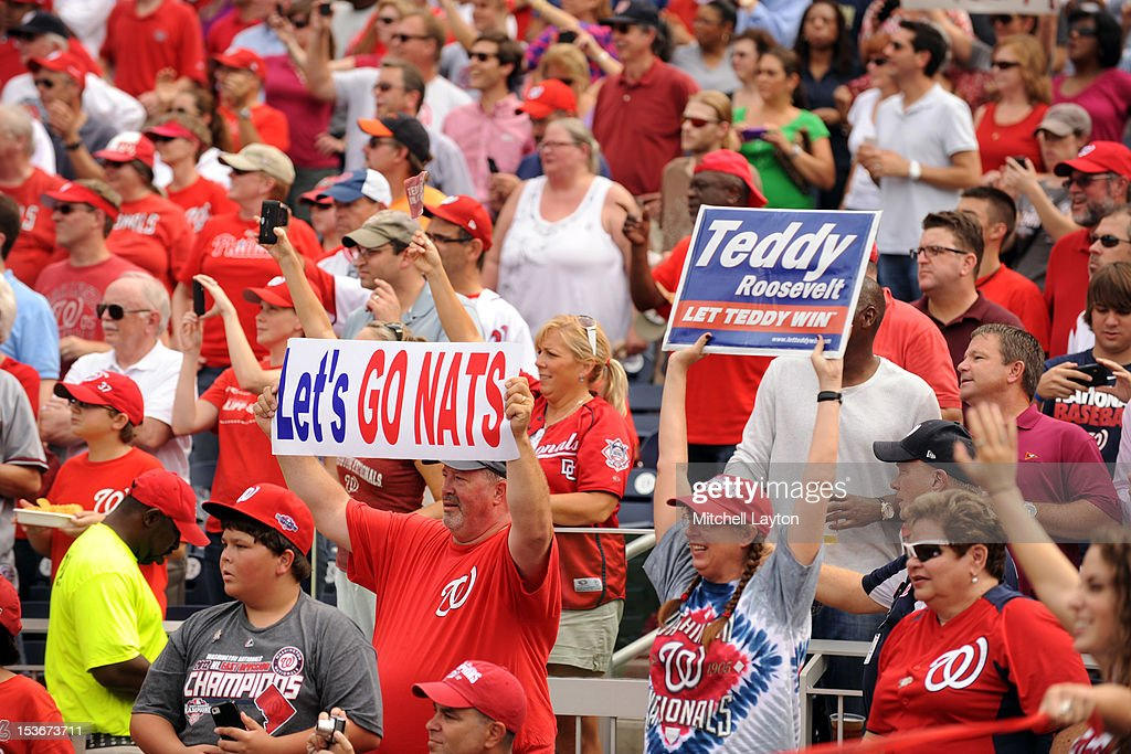 Washington Nationals fans cheer during a baseball game against the Philadelphia Phillies on October 3, 2012 at Nationals Park in Washington, DC. The Nationals won 5-1.