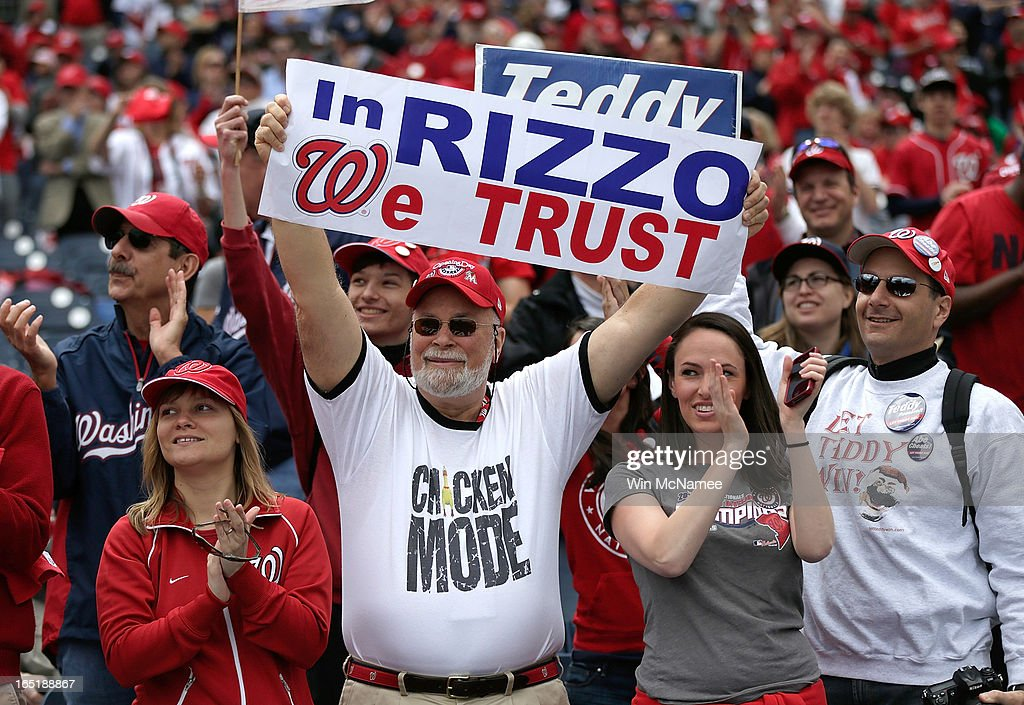 Washington Nationals fans cheers General Manager Mike Rizzo before the Opening Day game against the Miami Marlins at Nationals Park on Monday, April 1, 2013 in Washington, DC.