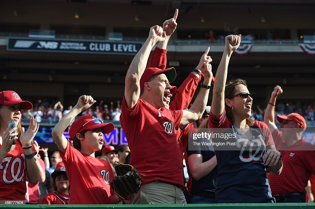 Washington Nationals fans including John Dowd (center) of Washington and his son, J.P. Dowd, 10, celebrate <a gi-track='captionPersonalityLinkClicked' href=/galleries/search?phrase=Bryce+Harper&family=editorial&specificpeople=5926486 ng-click='$event.stopPropagation()'>Bryce Harper</a>'s fourth inning home run against the New York Mets on opening day at Nationals Park on April 6, 2015 in Washington, DC.