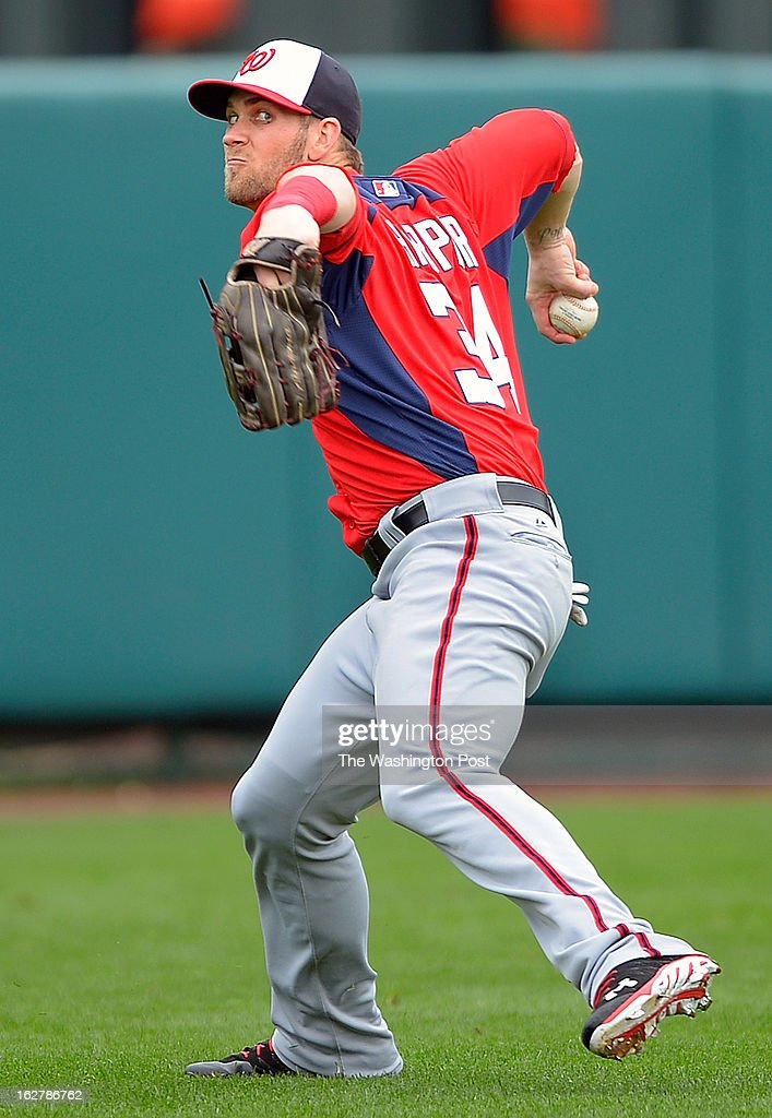 Washington Nationals fielder Bryce Harper (34 fires the ball home after fielding a RBI hit by Atlanta Justin Upton as the Washington Nationals lose to the Atlanta Braves 11 - 5 in Grapefruit League baseball in Kissimmee FL, February 26, 2012 .