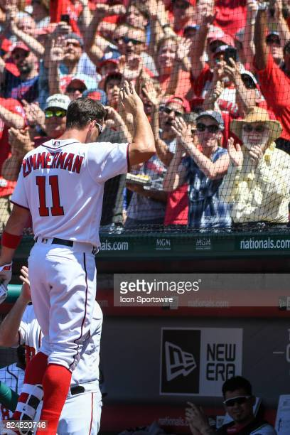Washington Nationals first baseman Ryan Zimmerman acknowledges the crowd after hitting a three run home run in the third inning to become the...