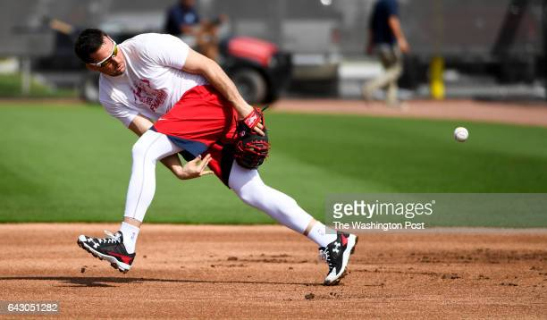 Washington Nationals first baseman Ryan Zimmerman makes a nifty between the legs throw to first while taking infield practice at the Ballpark of the...