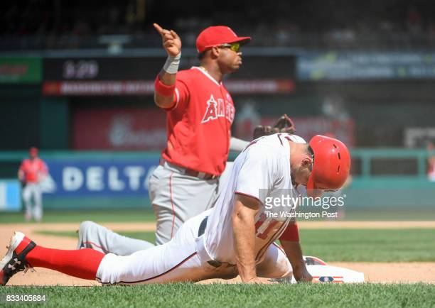 Washington Nationals first baseman Ryan Zimmerman reacts after he is tagged out by Los Angeles Angels third baseman Luis Valbuena in the eighth...