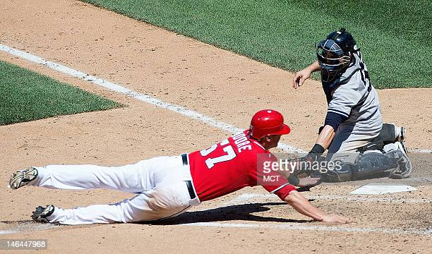 Washington Nationals first baseman Tyler Moore is tagged out at home plate by New York Yankees catcher Russell Martin during the eight inning at...
