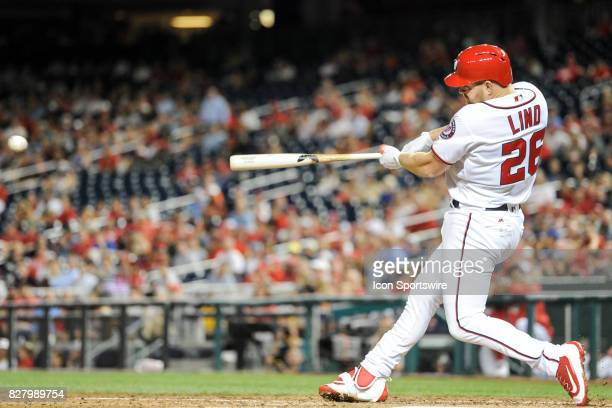 Washington Nationals left fielder Adam Lind hits an eighth inning single during an MLB game between the Miami Marlins and the Washington Nationals on...