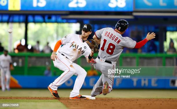 Washington Nationals left fielder Ryan Raburn slides as Miami Marlins shortstop JT Riddle tag him out during the third inning on Wednesday June 21...