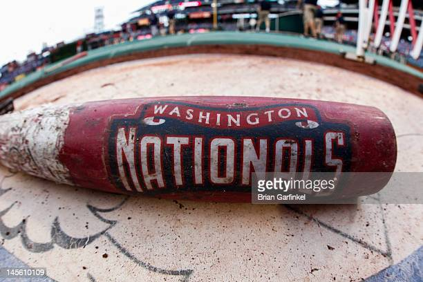 Washington Nationals logo is seen on a bat in the on deck circle before the game against the Philadelphia Phillies at Citizens Bank Park on May 23...