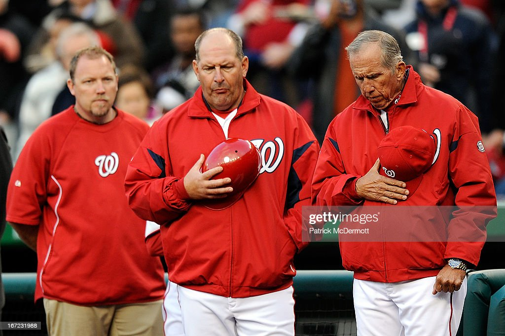 Washington Nationals Manager <a gi-track='captionPersonalityLinkClicked' href=/galleries/search?phrase=Davey+Johnson+-+Baseball+Manager&family=editorial&specificpeople=93273 ng-click='$event.stopPropagation()'>Davey Johnson</a> (R) and Trent Jewett #44 (C) take part in a moment of silence to honor the victims of the Boston Marathon bombing before the start of a game between the St. Louis Cardinals and Washington Nationals at Nationals Park on April 22, 2013 in Washington, DC.