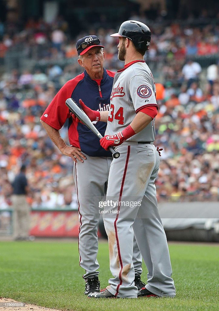 Washington Nationals manager Davey Johnson #5 checks on <a gi-track='captionPersonalityLinkClicked' href=/galleries/search?phrase=Bryce+Harper&family=editorial&specificpeople=5926486 ng-click='$event.stopPropagation()'>Bryce Harper</a> #34 during the seventh innng of the game against the Detroit Tigers at Comerica Park on July 31, 2013 in Detroit, Michigan. The Tigers defeated the Nationals 11-1.