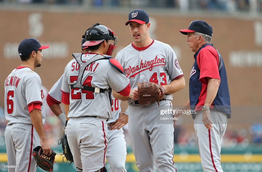 Washington Nationals manager Davey Johnson #5 talks with pitcher <a gi-track='captionPersonalityLinkClicked' href=/galleries/search?phrase=Ross+Ohlendorf&family=editorial&specificpeople=4172563 ng-click='$event.stopPropagation()'>Ross Ohlendorf</a> #43 of the Nationals in the fourth inning during the game against the Detroit Tigers at Comerica Park on July 31, 2013 in Detroit, Michigan.