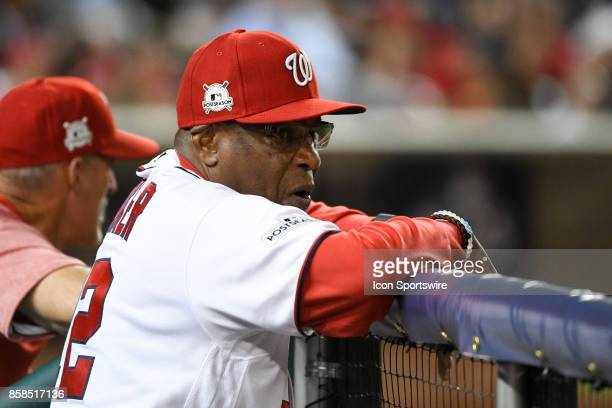 Washington Nationals manager Dusty Baker goes the top step of the dugout in the ninth inning in the first game of the National League Division Series...