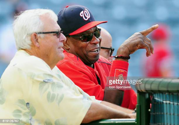 Washington Nationals manager Dusty Baker leans on the batting cage while talking to nationals scout Bob Boone during batting practice before a game...