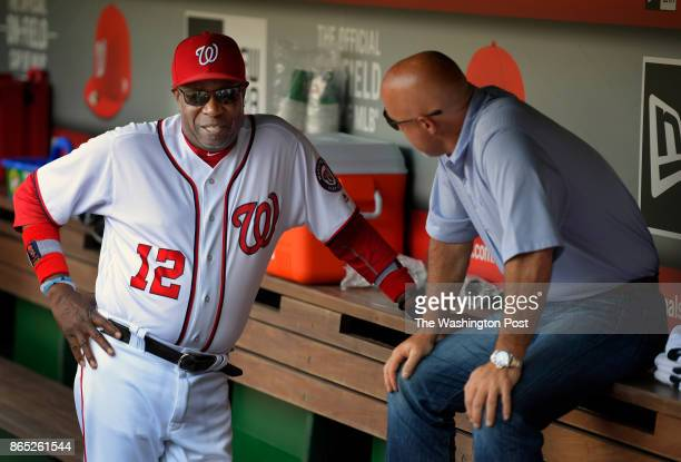 Washington National's manager Dusty Baker left confers with Nationals GM Mike Rizzo in the dugout before the Washington Nationals defeat of the...