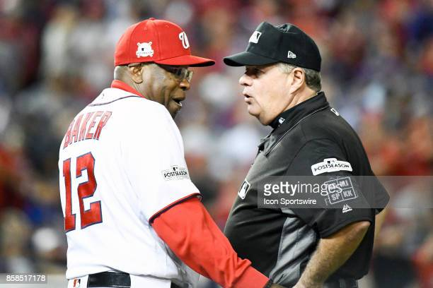 Washington Nationals manager Dusty Baker questions a ninth inning call with crew chief umpire Fieldin Culbreth in the first game of the National...