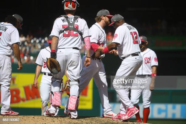 Washington Nationals manager Dusty Baker takes the ball from Washington Nationals relief pitcher Shawn Kelley who gave up the tying run to the...