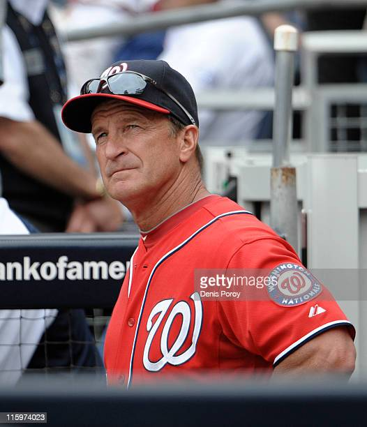 Washington Nationals manager Jim Riggleman looks out from the dugout during the ninth inning of a baseball game against the San Diego Padres at Petco...
